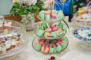 Wedding decoration with pastel colored cupcakes, meringues