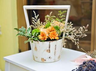 Flower arrangement in white vintage pot. Wedding decoration