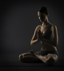 Yoga woman meditate sitting in lotus pose. Silhouette exercise