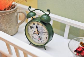 Vintage green colored clock. Retro alarm clock. Vintage clock