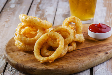 fried onion rings with red sauce