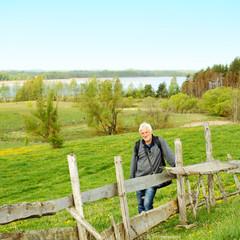 Elderly man travels in wildlife.