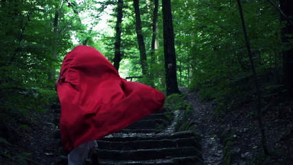 Red riding hood running away in forest, super slow motion, 240fp