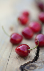 cherries on a rough wooden surface