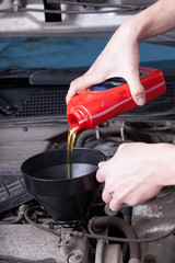 Man changing motor oil
