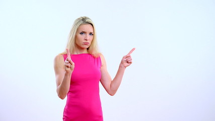 Young beautiful blond woman shows the ban