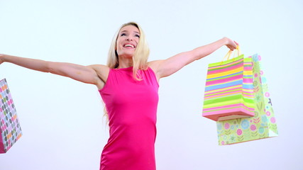Young beautiful woman with shopping bag on the white background
