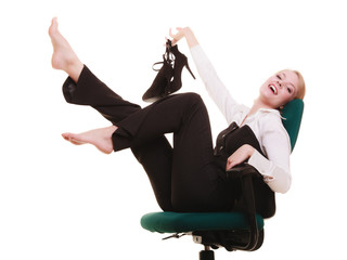 Break from work. Businesswoman relaxing on chair.