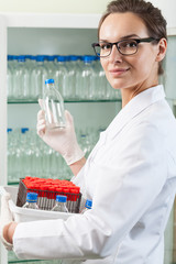 Lab assistant working in laboratory