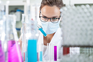 Woman analyzing liquid in test tube