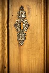 Closeup vintage wooden door with metal ornament