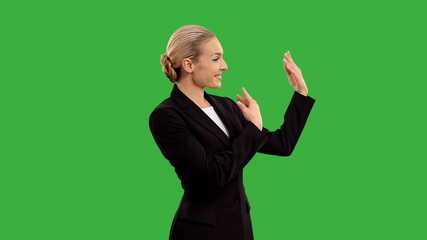 businesswoman presenting and show sign okay isolated on green sc