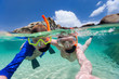 Family snorkeling in tropical water - 68301819