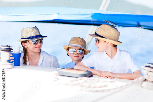 Mother and kids at luxury yacht