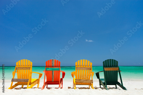 Colorful chairs on Caribbean beach - 68301898