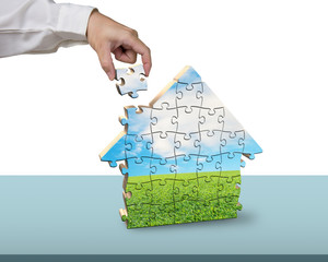 Finishing to assemble house shape puzzles