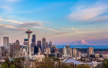 Seattle downtown skyline and Mt. Rainier at sunset. WA