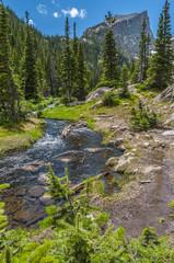 Glacier creek with Hallett Peak