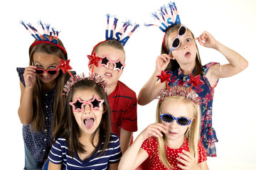 Five cousins dressed patriotic being silly with funny expression