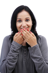 Young woman covering mouth with her hands