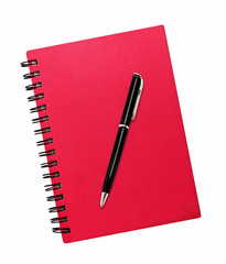 Red notepad isolated with ballpoint pen