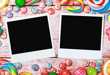 picture frame lies on sweets and candies