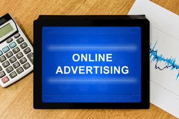 online advertising word on digital tablet