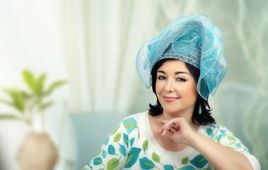 Woman wearing elegant sky blue hat