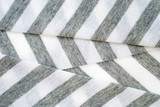 Folded gray and white striped cotton polyester texture. poster