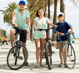happy family on vacation riding bicycles