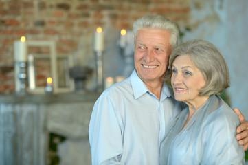 Elderly couple sitting in vintage interior