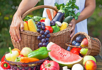 Summer fruit and vegetables with a woman holding the basket