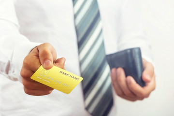 Businessman holding bank card.