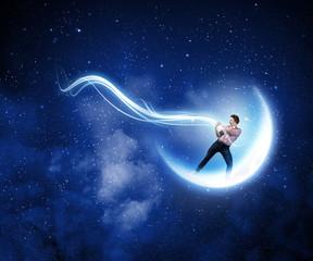 Man catching moon