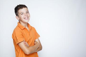 adorable young happy boy looking at camera