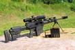 Leinwanddruck Bild - Sniper rifle caliber .50 BMG with ammo.