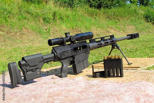 Leinwanddruck Bild Sniper rifle caliber .50 BMG with ammo.