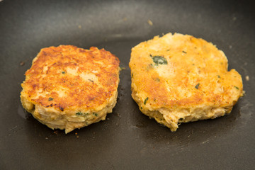 Two Crab Cakes Frying