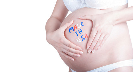 "Pregnant belly with ""Made in USA"" sign isolated"