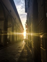 Sunrays in the old street of Florence