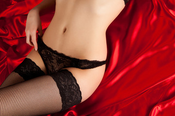 Black lingerie on red silk
