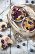 two clafoutis with blueberries and cherries on rustic background - 68316655