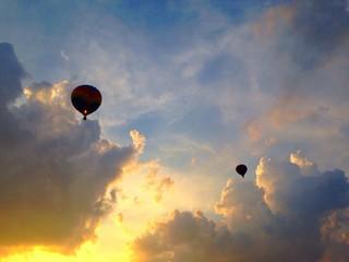 2 hot air balloons at sunset