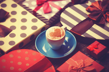 Cup of coffee and christmas gifts.