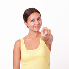 Young latin girl pointing at you