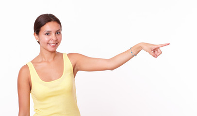 Cute latin female pointing to her left