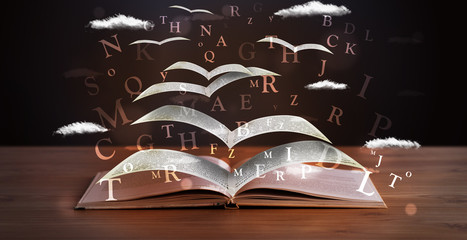 Pages and glowing letters flying out of a book