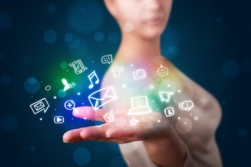 Young woman presenting colorful social media icons