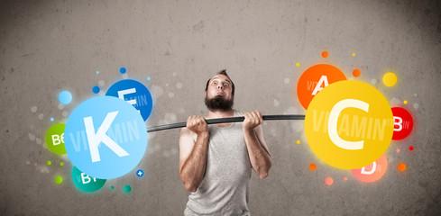skinny guy lifting colorful vitamin weights