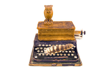 antique typewriter with owl and old book isolated on white